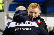 Ian Holloway Manager of Millwall and Neil Lennon Manager of Bolton Wanderers enjoy an embrace before the Sky Bet Championship match at The Den, London<br /> Picture by David Horn/Focus Images Ltd +44 7545 970036<br /> 19/12/2014