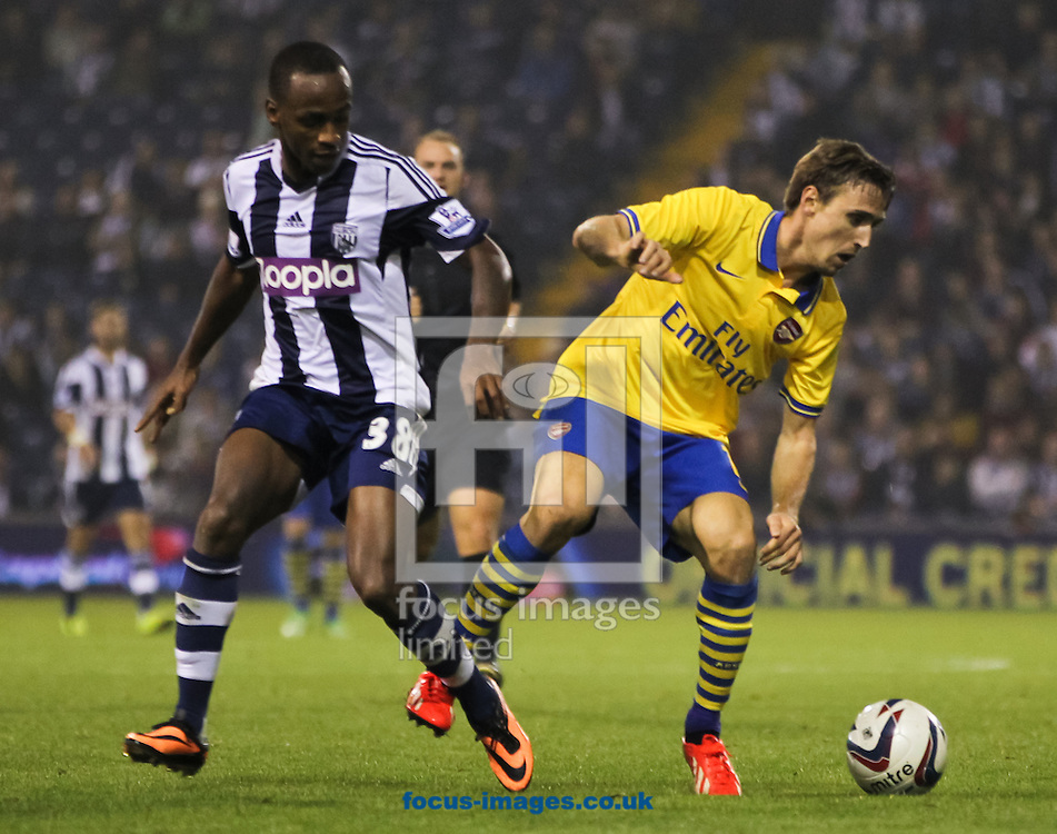 Picture by Tom Smith/Focus Images Ltd 07545141164<br /> 25/09/2013<br /> Saido Berahino (left) of West Bromwich Albion and Nacho Monreal of Arsenal fight for the ball during the Capital One Cup match at The Hawthorns, West Bromwich.