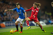 Stevie May (#17) of Aberdeen FC tackles Ryan Jack (#8) of Rangers FC during the Ladbrokes Scottish Premiership match between Rangers and Aberdeen at Ibrox, Glasgow, Scotland on 5 December 2018.