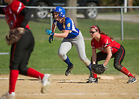 Gilford's Mattice (7) heads home from third during NHIAA Division III Softball with Laconia Wednesday afternoon.  (Karen Bobotas/for the Laconia Daily Sun)