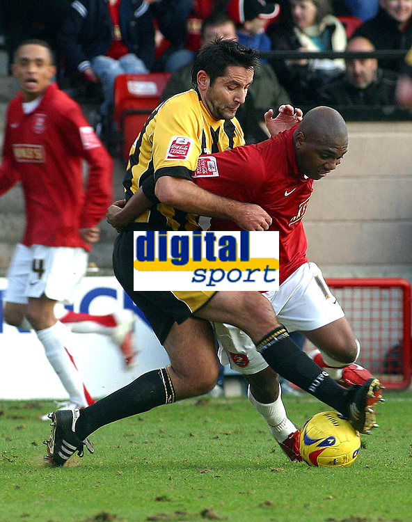 Photo: Dave Linney.<br />Walsall v Boston United. Coca Cola League 2. 27/01/2007.<br />Walsall's Hector Sam(r) fends off the challenge from Boston's  Paul Ellender.