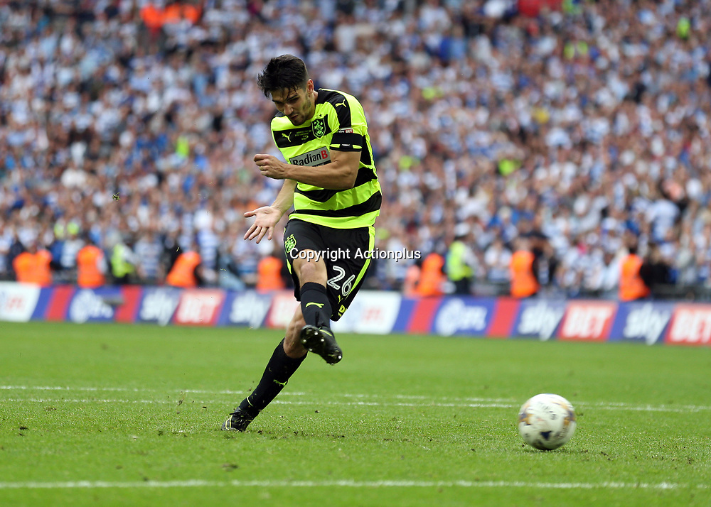 May 29th 2017, Wembley Stadium, London, England; EFL Championship playoff final, Huddersfield Town versus Reading; Christopher Schindler of Huddersfield Town scores the winning penalty to promote Huddersfield Town into the Premier League