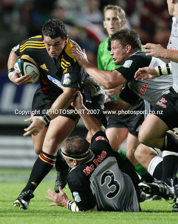 Chiefs Simms Davison powers out of a tackle during the Super 14 rugby match between the Chiefs and the Sharks at Waikato Stadium, Hamilton, New Zealand on Saturday 21 April 2007. Photo: Stephen Barker/PHOTOSPORT<br /> <br /> <br /> 210407