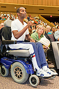 Aug 26, 2009 -- PHOENIX, AZ: WESLEY POWELL, who has multiple sclerosis argues for health care reform during a town hall meeting on health care reform sponsored by Sen John McCain at North Phoenix Baptist Church in Phoenix, AZ, Wednesday. Sen McCain hosted his second town hall meeting on health care in two days Wednesday. About 1,000 people attended the meeting. Although most were opposed to President Obama's health care proposals and supported Sen McCain, there was a large group who support the President's health care efforts.  Photo by Jack Kurtz
