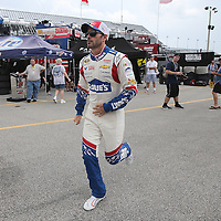 Driver Jimmie Johnson runs to his garage area during the first practice session of the 56th Annual NASCAR Coke Zero400 race at Daytona International Speedway on Thursday, July 3, 2014 in Daytona Beach, Florida.  (AP Photo/Alex Menendez)