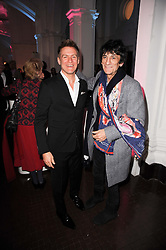 Left to right, BRYAN ADAMS and RONNIE WOOD at an exhibition and charity auction entitled Shoebox Art in aid of Kids Company held at the Haunch of Venison, Burlington Gardens, London on 18th March 2010.