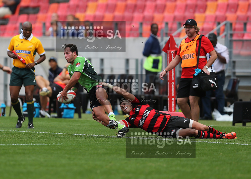 PORT ELIZABETH, SOUTH AFRICA - Saturday 25 April 2015, Ronnie Cooke of Eastern Province Kings drags Gerhardus Smith of SWD Eagles out of bounds during the Vodacom Cup rugby match between Eastern Province Kings and SWD Eagles at the Nelson Mandela Bay stadium. <br /> Photo by Richard Huggard/ImageSA/SARU