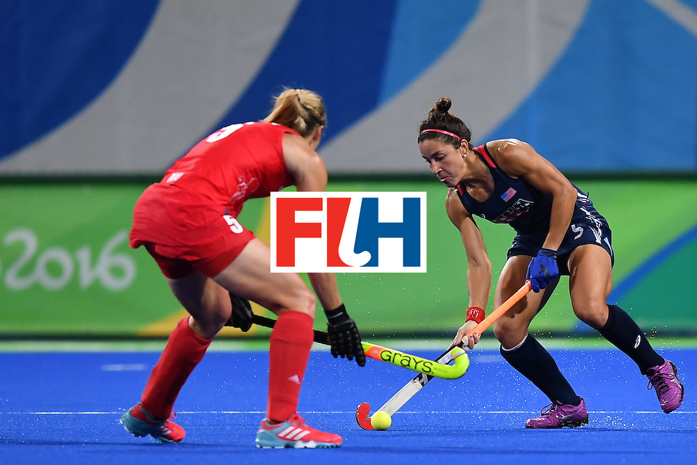 Britain's Crista Cullen (L) and USA's Melissa Gonzalez vie during the women's field hockey Britain vs the USA match of the Rio 2016 Olympics Games at the Olympic Hockey Centre in Rio de Janeiro on August, 13 2016. / AFP / MANAN VATSYAYANA        (Photo credit should read MANAN VATSYAYANA/AFP/Getty Images)
