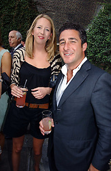 The HON.FLORA HESKETH and LUCA DEL BONO at the Tatler Summer Party 2006 in association with Fendi held at Home House, Portman Square, London W1 on 29th June 2006.<br />