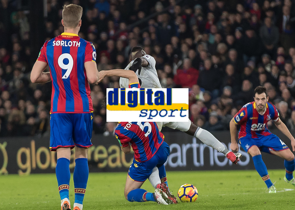 Football - 2017 / 2018 Premier League - Crystal Palace vs. Manchester United<br /> <br /> James Tomkins (Crystal Palace) brings down Paul Pogba (Manchester United) as he tries to break away at Selhurst Park.<br /> <br /> COLORSPORT/DANIEL BEARHAM
