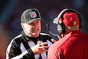 An official discusses a penalty call with Arizona Cardinals head coach Bruce Arians on the sideline during the 2015 week 12 regular season NFL football game against the San Francisco 49ers on Sunday, Nov. 29, 2015 in Santa Clara, Calif. The Cardinals won the game 19-13. (©Paul Anthony Spinelli)