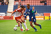 Wigan Jamal Lowe and Barnsley Toby Sibbick during the EFL Sky Bet Championship match between Wigan Athletic and Barnsley at the DW Stadium, Wigan, England on 31 August 2019.