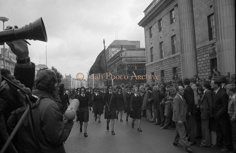 Sinn Fein (Provo) Dublin Parade.   K22..1976..25.04.1976..04.25.1976..25th April 1976..Sinn Fein held an Easter Rising Commemorative  parade..The parade started at St Stephens Green, Dublin and proceeded through the streets to the G.P.O.in O'Connell Street, the scene of the centre of the 1916 uprising..Image of a para military group of young women as they parade in front of the G.P.O.