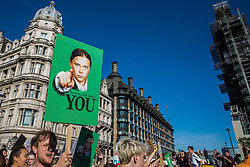 London, UK. 20 September, 2019. Students and climate campaigners march with an image of Greta Thunberg during the second Global Climate Strike in protest against a lack of urgent action by the UK Government to combat the global climate crisis. The Global Climate Strike grew out of the Fridays for Future movement and is organised in the UK by the UK Student Climate Network.