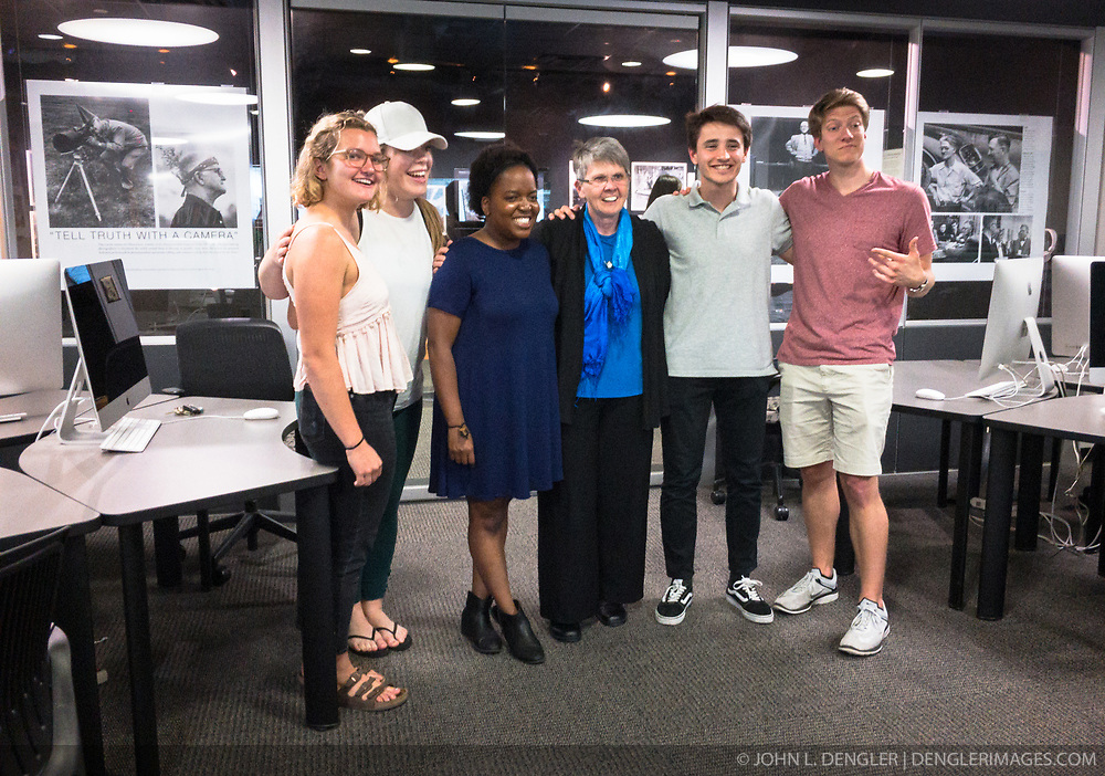 reception was held for Rita Reed, photojournalism professor at the Missouri School of Journalism, to celebrate her retirement after 16 years of being on the faculty. <br /> <br /> In this photo, Reed poses for a photo with some of her current students.<br /> <br /> The event was held on May 10, 2017 in the Cliff and Vi Edom Photojournalism Lab in Lee Hills Hall on the University of Missouri campus in Columbia, Mo.<br /> <br /> The following is from Reed&rsquo;s bio posted on the Missouri School of Journalism website: &quot;Rita Reed joined the photojournalism faculty in 2001 after 20 years as a working photojournalist with Star Tribune in Minneapolis and The Gazette in Cedar Rapids, Iowa. She has worked not only on local, regional and national stories, but also internationally in Haiti, Bolivia, Colombia, Taiwan, China and the countries of the former Eastern Block.<br /> <br /> Reed holds a master&rsquo;s degree in journalism from the University of Missouri and an undergraduate degree from Southwest Missouri State University. She was the 1993 recipient of the Nikon Sabbatical Grant for Documentary Photography for the completion of work on a photographic book about gay and lesbian teenagers. Reed maintains an interest in and concern for adolescents and the issues they face. She is the director of the College Photographer of the Year competition.&rdquo;
