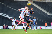 Milton Keynes Dons midfielder Conor McGrandles (18) heads the ball during the EFL Sky Bet League 1 match between Milton Keynes Dons and Charlton Athletic at stadium:mk, Milton Keynes, England on 17 February 2018. Picture by Dennis Goodwin.