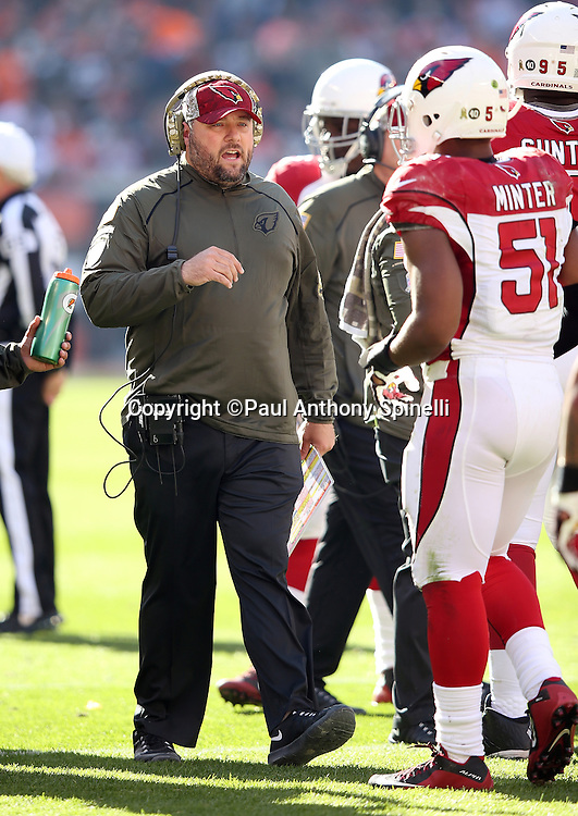 Arizona Cardinals defensive coordinator James Bettcher calls out to Arizona Cardinals middle linebacker Kevin Minter (51) during a break in the action during the 2015 week 8 regular season NFL football game against the Cleveland Browns on Sunday, Nov. 1, 2015 in Cleveland. The Cardinals won the game 34-20. (©Paul Anthony Spinelli)