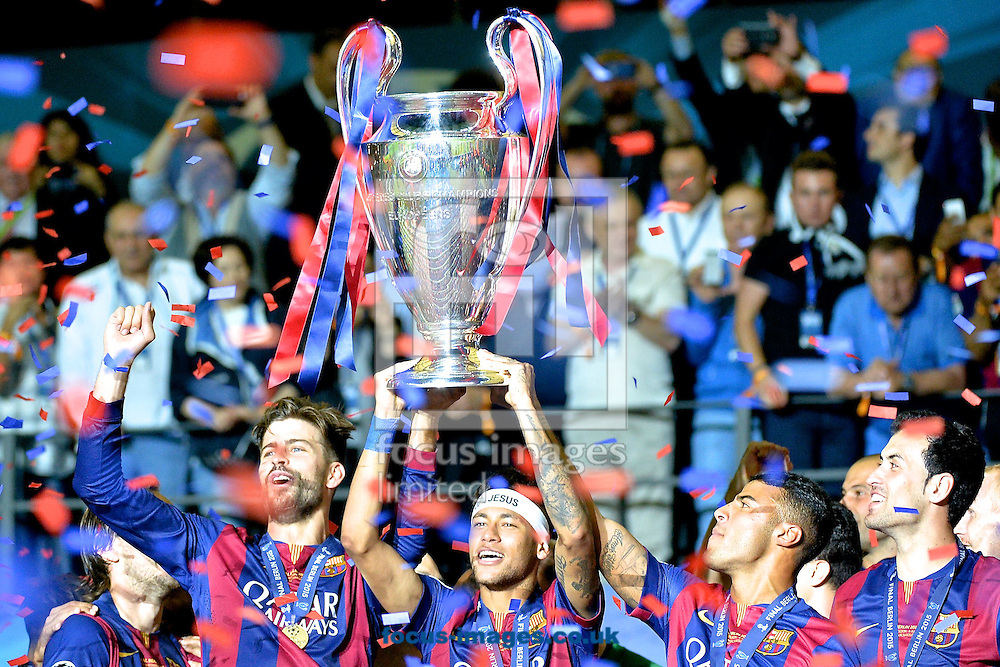 Gerard Piqu&eacute; of FC Barcelona (left) and Neymar (2nd left)  celebrate with the trophy following the UEFA Champions League Final at Olympiastadion Berlin, Charlottenburg-Wilmersdorf<br /> Picture by Ian Wadkins/Focus Images Ltd +44 7877 568959<br /> 06/06/2015