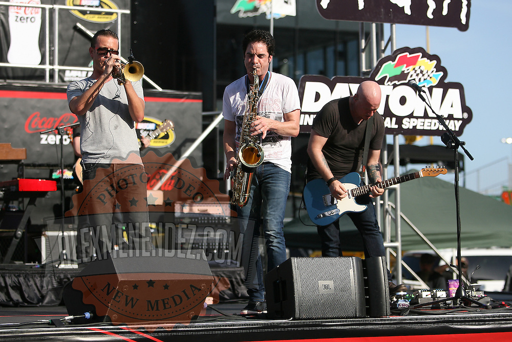 Pat Monahan of the Grammy award winning band Train, plays the saxophone during a one hour performance prior to the start of the NASCAR Coke Zero 400 race at Daytona International Speedway in Daytona Beach, Fl., on Saturday July 7, 2012. (AP Photo/Alex Menendez) Grammy Award winning band TRAIN plays an hour long concert prior to the NASCAR Coke Zero 400 race at Daytona International Speedway in Daytona Beach, Florida on July 7, 2012.