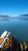 Kayaks trailing the Safari Endeavor at Glacier Bay NP