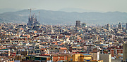 Spain, Barcelona. The skyline as seen from the steps of the Palau Nacional. The famous cathedral Sagrada Familia appears on the left.