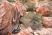 "Keenan Takahashi attempting a high ball boulder problem on ""The Nest"" Boulder in Red Rock Conservation Area Nevada"