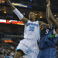 08 February 2009:  New Orleans Hornets forward David West (30) shoots past Minnesota Timberwolves center Al Jefferson (25) during a NBA game between the Minnesota Timberwolves and the New Orleans Hornets at the New Orleans Arena in New Orleans, LA.