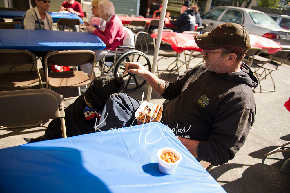 Lucky Jr's birthday party at Sunburn's Auto Repair.  Karen Bobotas for the Laconia Daily Sun
