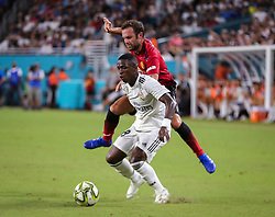 July 31, 2018 - Miami Gardens, Florida, USA - Manchester United F.C. defender Luke Shaw (23) (behind) vies for the ball with Real Madrid C.F. forward Vinicius Junior (28) during an International Champions Cup match between Real Madrid C.F. and Manchester United F.C. at the Hard Rock Stadium in Miami Gardens, Florida. Manchester United F.C. won the game 2-1. (Credit Image: © Mario Houben via ZUMA Wire)
