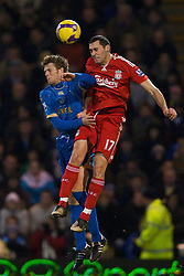 PORTSMOUTH, ENGLAND - Saturday, February 7, 2009: Liverpool's Alvaro Arbeloa and Portsmouth's Hermann Hreidarsson during the Premiership match at Fratton Park. (Mandatory credit: David Rawcliffe/Propaganda)