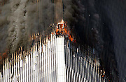 The north tower of the World Trade Center is on fire due to a terrorist act of a plane hittng the building in Manhattan, NY. 9/11/2001