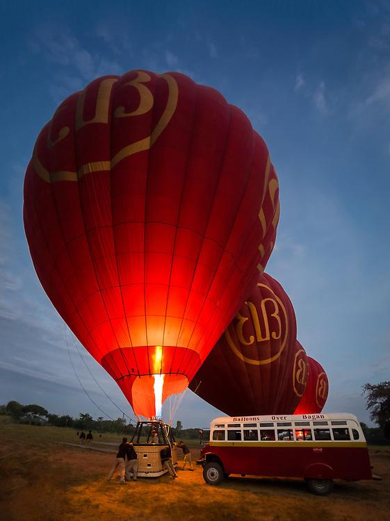 BAGAN, MYANMAR - CIRCA DECEMBER 2013: Hot air balloons getting ready to fly early morning in Bagan.