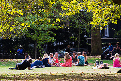 St James's Park, Westminster, September 13th 2016. With the Met Office forecasting temperatures of 30º, office workers and tourists enjoy the lunchtime sunshine in St James's Park, London.