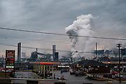 Steam rises from the quenching towers at the United States Steel Coke Works in Clairton, Pa.<br /> <br /> The Clairton Works, the largest coke manufacturing facility in the United States, is one of the biggest sources of air quality complaints in the region. Making coke is one of the dirtiest processes in making steel.<br /> <br /> The plant carbonizes coal to make coke, a fuel necessary to make steel.