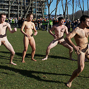 The 'Nude Blacks' perform The Haka before the start of the 'Nude Blacks' versus a Fijian invitation side played at Logan Park, Dunedin as an unofficial curtain raiser match before the New Zealand V Fiji test match in Dunedin, New Zealand...The 'Nude Blacks' won the match 20-10 with 21 year old female player Rachel Scott, a member of the Otago women's rugby team named player of the day. .Over 500 people turned up to watch the match which included a blind referee, Julie Woods and three clothed streakers who were ejected from the playing area..The 'Nude Blacks' traditionally play games before test matches in Dunedin and were using this match as a warm up for three nude games planned during the IRB Rugby World Cup in New Zealand with teams from Argentina, Italy, England and Ireland involved.  Matches will be played before World Cup games in Dunedin. New Zealand. 22nd July 2011. Photo Tim Clayton