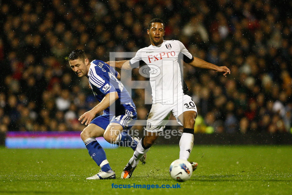 Picture by Andrew Tobin/Focus Images Ltd. 07710 761829. 09/04/12 Gary Cahill of Chelsea is tackled by Moussa Dembeleof Fulham during the during the Barclays Premier League match between Fulham and Chelsea at Craven Cottage stadium, London