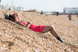 © Licensed to London News Pictures. 03/10/2017. Brighton, UK. Members of the public relax and enjoy the autumn sunshine on the beach in Brighton and Hove. Photo credit: Hugo Michiels/LNP