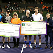 March 1, 2014, Indian Wells, California: <br /> Checks are presented to Childhelp and the Eisenhower Medical Center Foundation during the McEnroe Challenge for Charity presented by Esurance. <br /> (Photo by Billie Weiss/BNP Paribas Open)