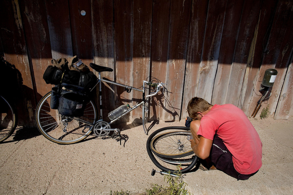 Ben Depp patches a tire at the Western Cafe. Highway 20, Gordon, Sheridan County, Nebraska, 8/31/2007 Photo by Alexis Erkert