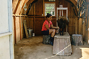 Peach Bottom, Pennsylvania - May 17, 2017: Mika McDougall milks Pinky in her milking shed Wednesday May 17, 2017.<br /> <br /> <br /> Chris McDougall and his rescue donkey Sherman regularly run with a group of two other runners and two donkeys among the Amish farms in rural Pennsylvania.<br /> <br /> CREDIT: Matt Roth for The New York Times<br /> Assignment ID: 30206505A