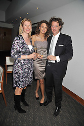Left to right, NAOMI HANCOCK, OLIVIA COLE and RICHARD HAINES at a dinner hosted by Ruinart Champagne for Yasmin Mills at Nobu, Park Lane, London on rth May 2009.