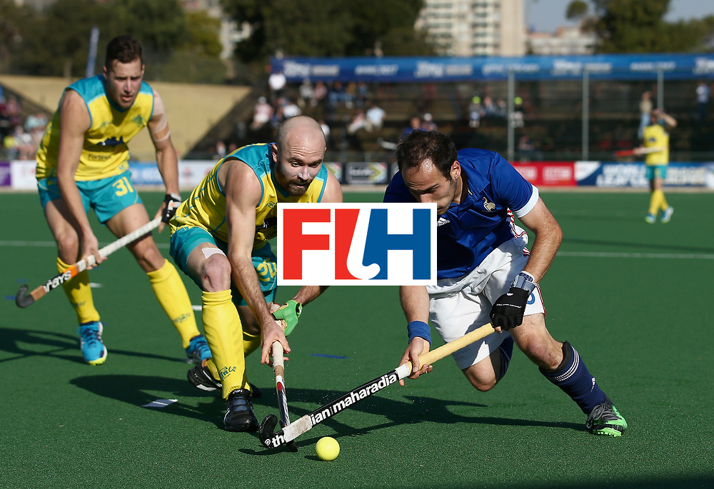 JOHANNESBURG, SOUTH AFRICA - JULY 11: Pieter van Straaten of France and Matthew Swann of Australia battle for possession during day 2 of the FIH Hockey World League Semi Finals Pool A match between Australia and France at Wits University on July 11, 2017 in Johannesburg, South Africa. (Photo by Jan Kruger/Getty Images for FIH)