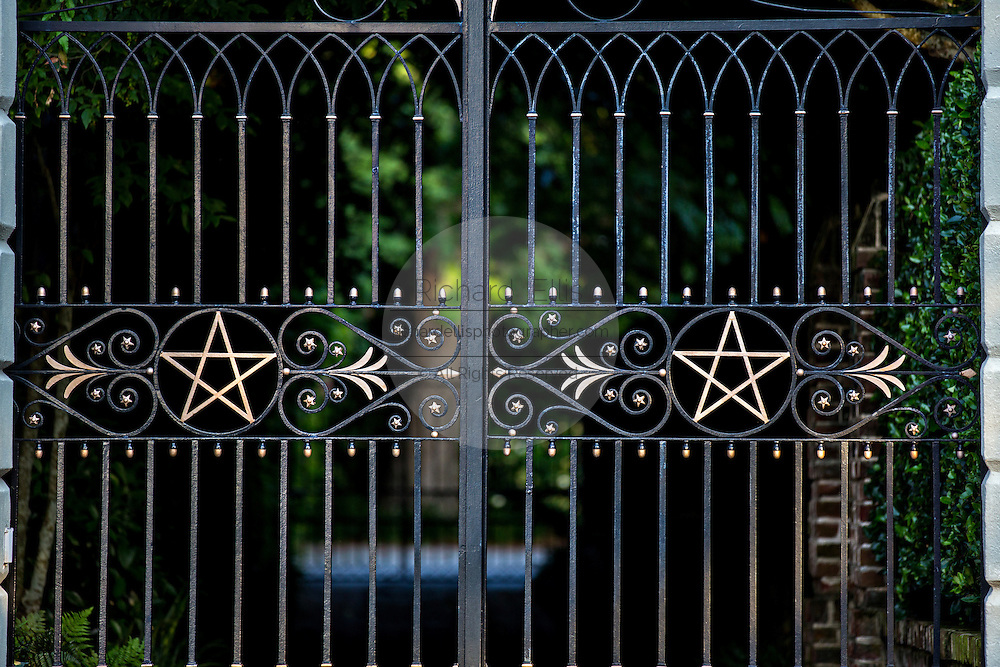 Decorative iron gates at a stately antebellum historic homes along the High Battery in Charleston, SC.