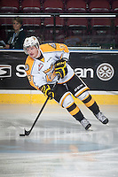 KELOWNA, CANADA - OCTOBER 25: Rihards Bukarts #13 of Brandon Wheat Kings skates with the puck during warm up against the Kelowna Rockets on October 25, 2014 at Prospera Place in Kelowna, British Columbia, Canada.  (Photo by Marissa Baecker/Shoot the Breeze)  *** Local Caption *** Rihards Bukarts;