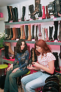 Tel Aviv, Israel, two young women buying shoes in a shoe store
