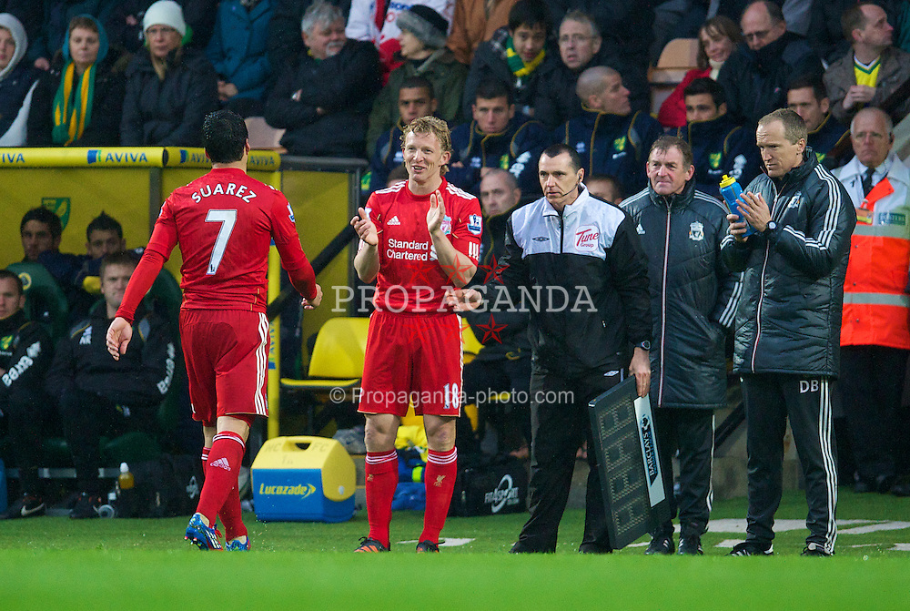 NORWICH, ENGLAND - Saturday, April 28, 2012: Liverpool's hat-trick hero Luis Alberto Suarez Diaz is applauded off the pitch by Dirk Kuyt during the 3-0 victory over Norwich City Premiership match at Carrow Road. (Pic by David Rawcliffe/Propaganda)