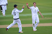 Gareth Berg congratulates Brad Wheal of Hampshire for his wicket of John Simpson of Middlesex during the Specsavers County Champ Div 1 match between Hampshire County Cricket Club and Middlesex County Cricket Club at the Ageas Bowl, Southampton, United Kingdom on 14 April 2017. Photo by David Vokes.