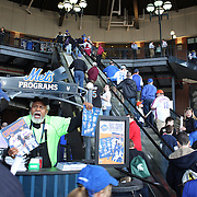 New York Mets fans arrive at Citi Field to watch opitcher Matt Harvey, New York Mets,  pitching during the New York Mets Vs Miami Marlins MLB regular season baseball game at Citi Field, Queens, New York. USA. 19th April 2015. Photo Tim Clayton