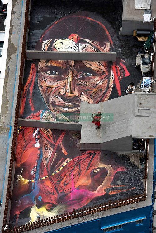 November 10, 2016 - Hong Kong, Hong Kong S.A.R, China - Rooftop painting by Parisian street artist Alexandre Monteiro aka Hopare of Masai warrior Daniel Ole Sambu (pictured) with photographer Sean Lee-Davies who arranged the project.Street art in Hong Kong ahead of the The √íHope for Wildlife√ì Gala Dinner painted to raise awareness for the plight of endangered animals the world over..Sheung Wan Hong Kong.10th November 2016. Photo by Jayne Russell. (Credit Image: © Jayne Russell via ZUMA Wire)