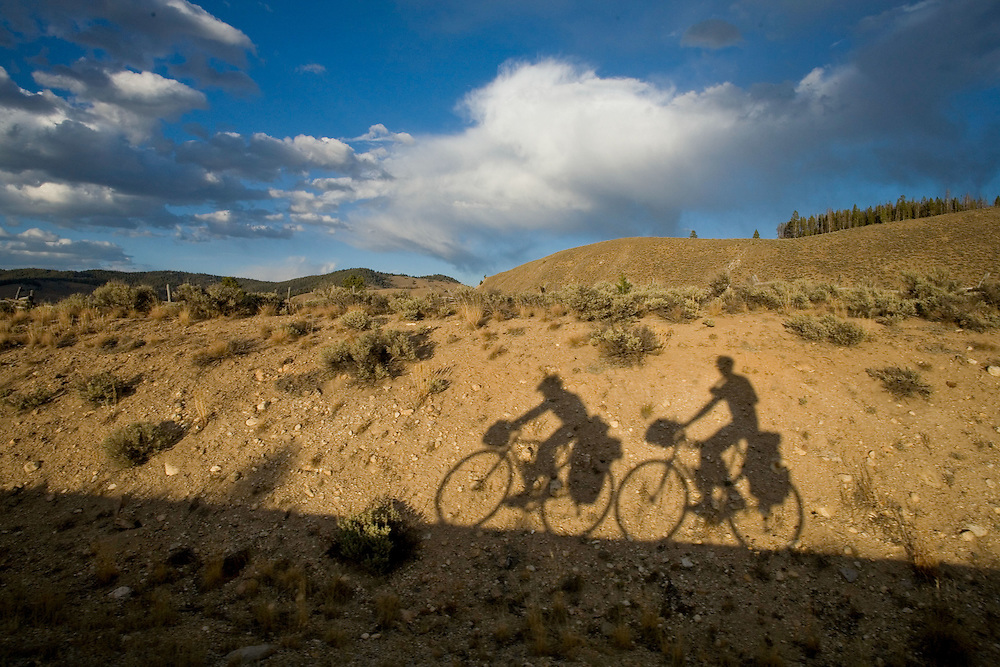 Shadows from Ben Depp and Alexis Erkert while cycling on the Ponderosa Pine Scenic Byway, Highway 21, Custer County, Idaho. 9/16/2007.Photo by Ben Depp